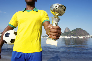 Champion Brazilian Soccer Player Holding Trophy and Football