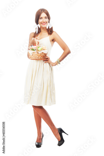 Lovely woman with a basket of cakes