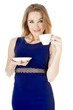 Beautiful woman  holding cup and saucer against white background