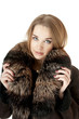 Elegant stylish woman in fur against white background