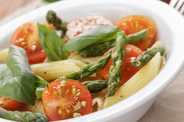 italian pasta penne with tomatoes and asparagus