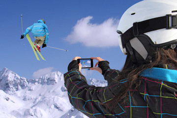 Mobile phone photographs of skiers jump
