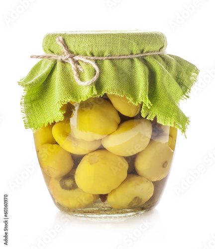 Marinated scalloped squash in glass jar isolated on white
