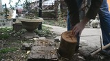 Lumber jack man chopping wood logs with ax. Making firewood
