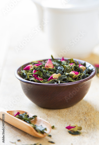 Green tea leaves with rose buds