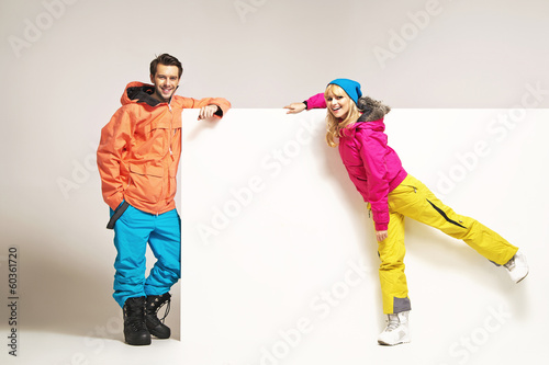 Attractive couple wearing colorful winter clothes