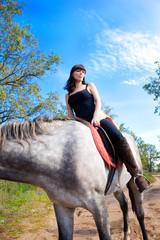 Girl on horse background of blue sky