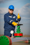 Oil worker turning valve