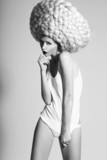Glamor. Image of Fashion Model In Unusual Wig in Artistic Pose