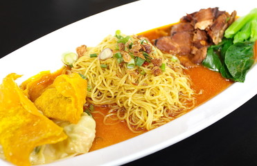 Egg chinese dry noodles with roast pork, dumpling
