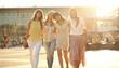 Four joyful girlfriends on the walk