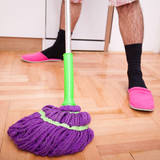 Young man cleaning and doing the housework