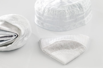Skull caps are worn by Muslim men, also known as the Keffiyeh