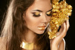 Eye Makeup. Beautiful Girl With Golden Flowers. Beauty Model Wom