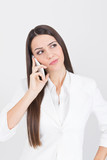 Beautiful young businesswoman speaking on the phone