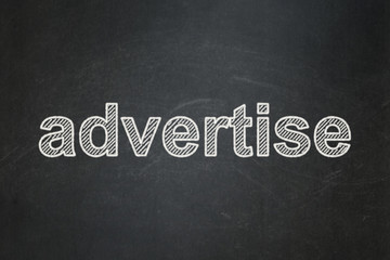 Advertising concept: Advertise on chalkboard background
