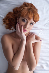 Portrait of seductive redhead beautiful woman