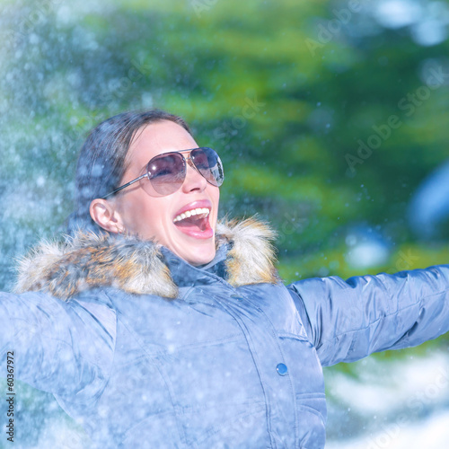 Cheerful female in winter park