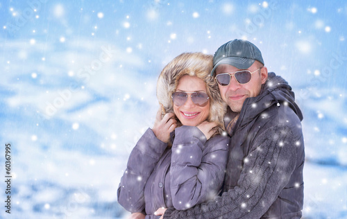 Happy couple under snowfall