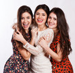 Group of three sexy, beautiful young happy women.