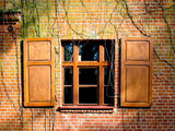 Window and shutters in a brick wall