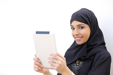 Arab woman holding a tablet and looking at camera