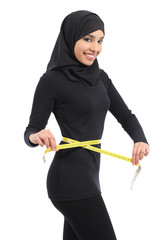 Beautiful arab saudi fitness woman with a tape measure