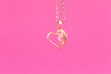 Gold heart on a chain - 60370337