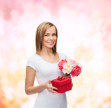 smiling woman with bouquet of flowers and gift box