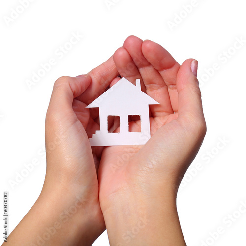 Paper House in Female Hands isolated on White Background.