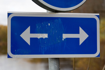 Traffic sign showing walk and cycle path to the right and left.