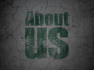 Marketing concept: About Us on grunge wall background