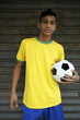Young Brazilian Football Player Holding Soccer Ball