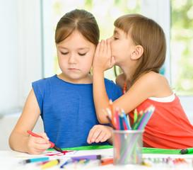 Little girls are drawing using felt- tip pens