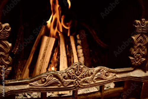 Logs burning in the fireplace, home atmosphere
