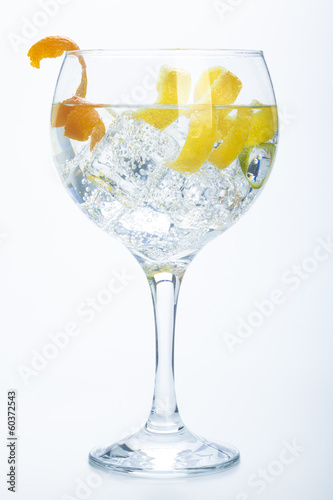 Fotobehang Cocktail orange lemon and lime gin tonic isolated over white