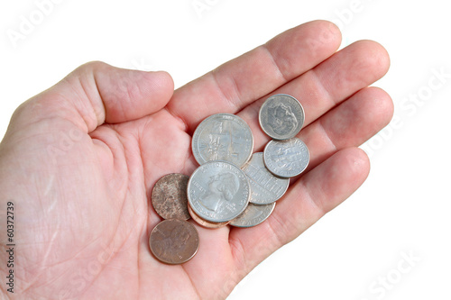 Hand with a few coins isolated on white