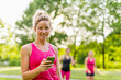 Portrait of a woman using her smart phone for a workout