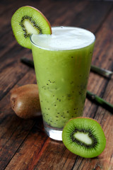 Kiwi juice on wooden background