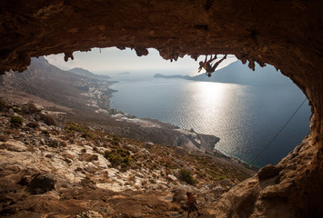 Family rock climber against picturesque view of Telendos