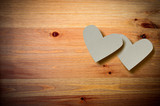 Valentine hearts on a wooden background.