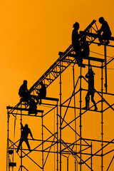 Silhouette of Workmen on assembling concert stage