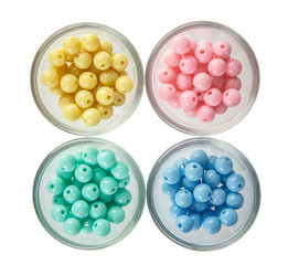 Colorful circle  beads in cup on white