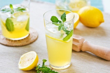 Lemonade with fresh lemon and mint by lemon reamer