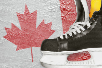 Hockey skates and Canadian flag