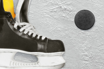 Hockey skates and puck