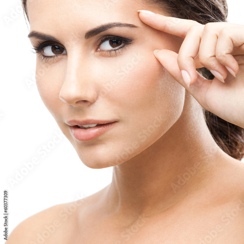 Woman touching skin or applying cream, isolated