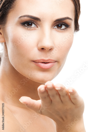 Beautiful woman, blowing kiss, on white
