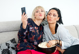 two woman friends making selfie picture poster