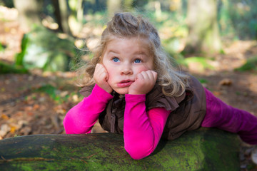 little girl is resting in the nature